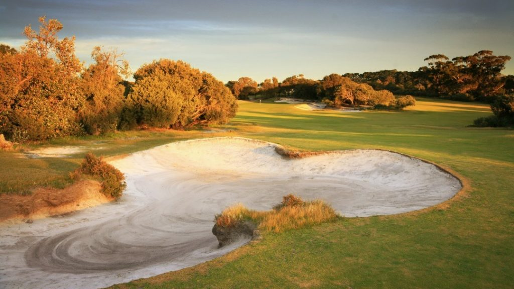 Aerial View of autumn trees and bunkers at The Royal Melbourne Golf Course, Melbourne, VIC
